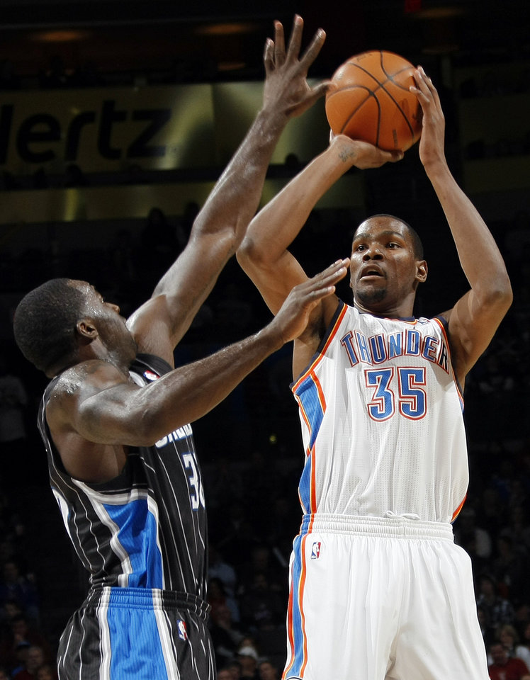 Oklahoma City's Kevin Durant (35) takes a shot over Brandon Bass (30) of Orlando during the NBA basketball game between the Orlando Magic and Oklahoma City Thunder in Oklahoma City, Thursday, January 13, 2011. Photo by Nate Billings, The Oklahoman