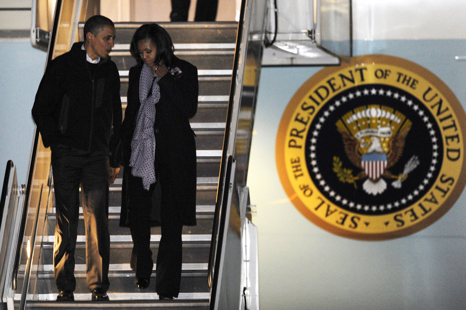 President Barack Obama and first lady Michelle Obama walk off Air Force One after arriving at O'Hare International Airport in Chicago, Tuesday, Nov. 6, 2012. (AP Photo/Paul Beaty)