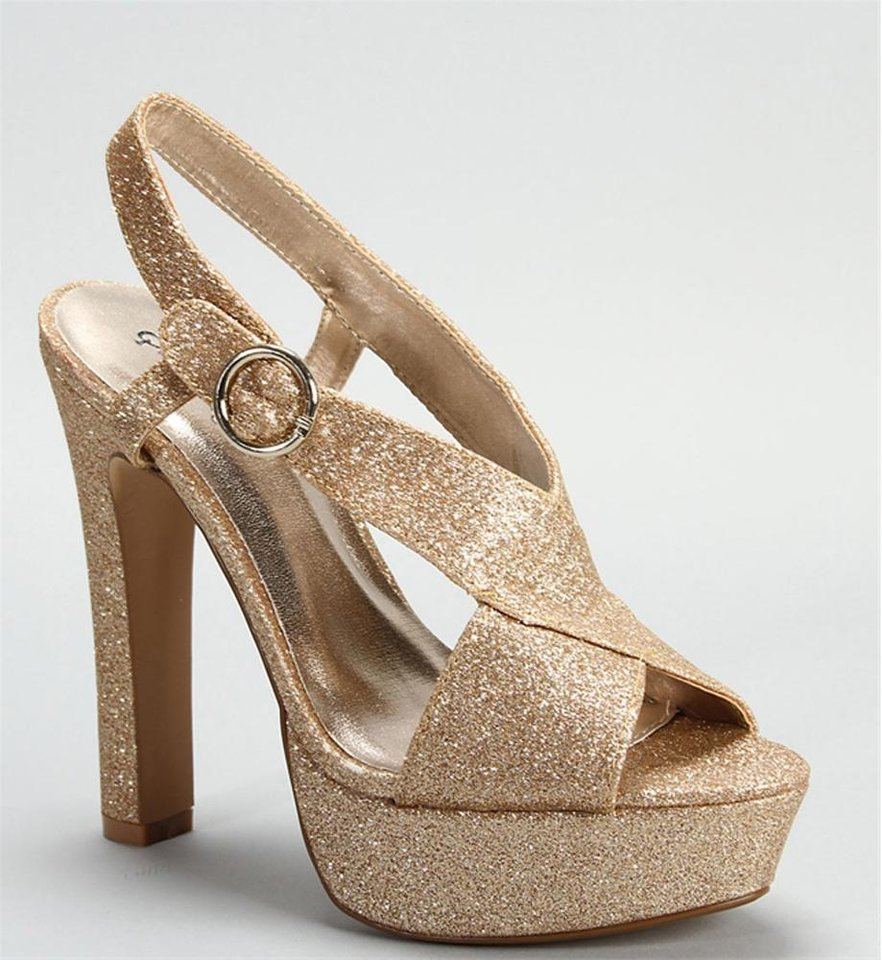 Photo - Champagne glitter cross strap shoe from Windsor, $34.90. (Courtesy Windsor.com via Los Angeles Times/MCT)
