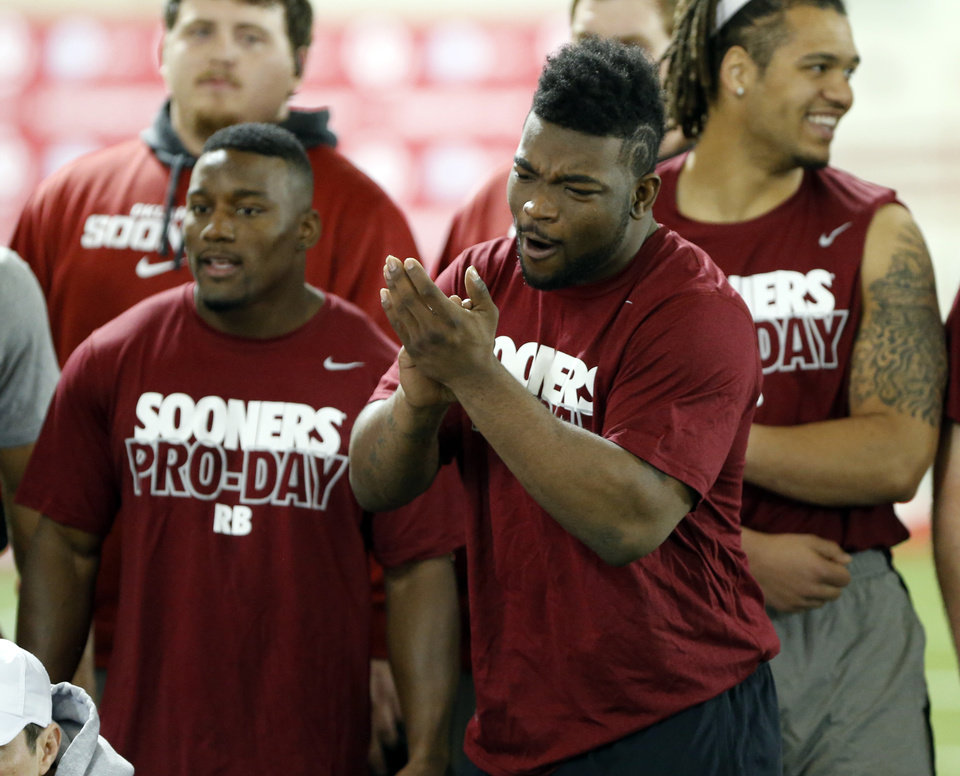 Photo - Damien Williams cheers players during the bench press as the University of Oklahoma holds Pro Day at the Everest Training Center in Norman, Okla., on Wednesday, March 12, 2014. Photo by Steve Sisney, The Oklahoman