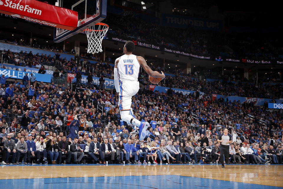 Photo - Oklahoma City's Paul George (13) goes up for a dunk after being fouled during the NBA basketball game between the Oklahoma City Thunder and the Portland Trail Blazers at Chesapeake Energy Arena in Oklahoma City, Tuesday, Jan. 22, 2019. Photo by Sarah Phipps, The Oklahoman