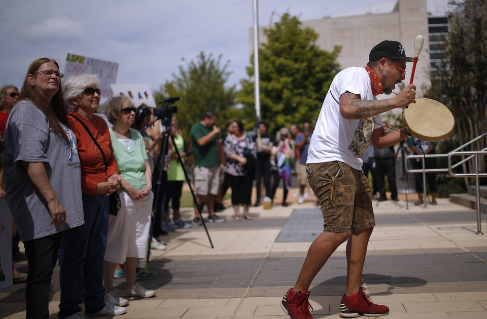 Photo - Quese Imc sings a war song during the Justice for Magdiel Sanchez rally in Oklahoma City, Sunday, Sept. 24, 2017. Photo by Sarah Phipps, The Oklahoman
