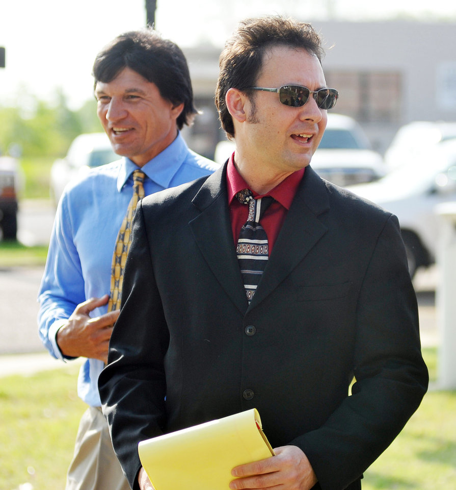 Photo - Paul Kevin Curtis, right, who had been in custody under the suspicion of sending letters which tested positive for ricin to U.S. President Barack Obama and U.S. Sen. Roger Wicker, R-Miss., and his brother Jack Curtis walk to a press conference in Oxford, Miss. on Tuesday, April 23, 2013. The charges were dismissed without prejudice, which means they could be re-instated if prosecutors so choose. (AP Photo/Oxford Eagle, Bruce Newman)