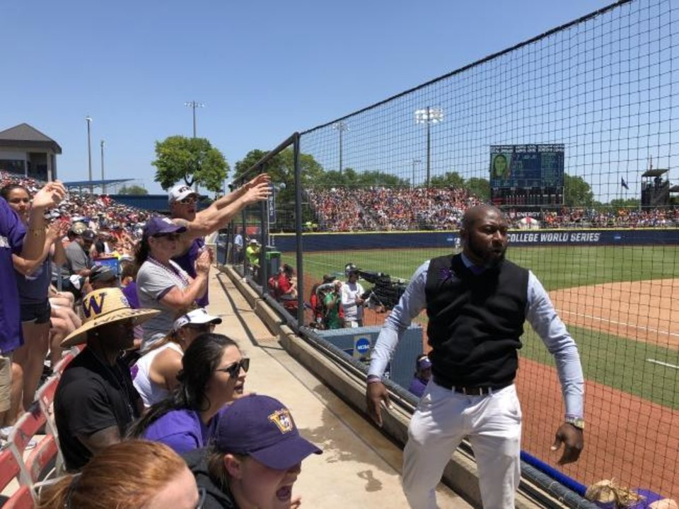 Photo -  LSU superfan DeAngelo Sanchez cheers on Washington during Thursday's Women's College World Series opener. [Jacob Unruh/The Oklahoman]