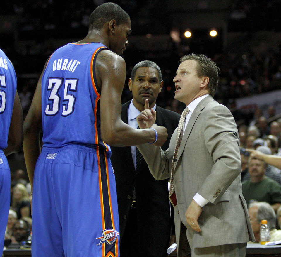 Oklahoma City\'s Kevin Durant (35) talks with coach Scot Brooks as assistant Maurice Cheeks watches after a technical foul during Game 2 of the Western Conference Finals between the Oklahoma City Thunder and the San Antonio Spurs in the NBA playoffs at the AT&T Center in San Antonio, Texas, Tuesday, May 29, 2012. Oklahoma City lost 120-111. Photo by Bryan Terry, The Oklahoman