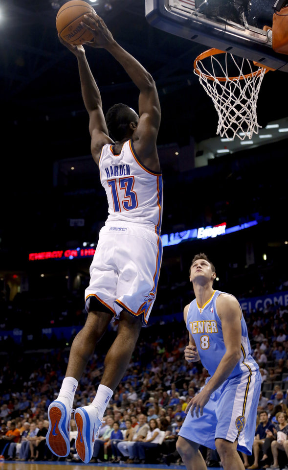 Oklahoma City's James Harden (13) dunks in front of Denver's Danilo Gallinari (8) during the NBA preseason basketball game between the Oklahoma City Thunder and the Denver Nuggets at the Chesapeake Energy Arena, Sunday, Oct. 21, 2012. Photo by Sarah Phipps, The Oklahoman