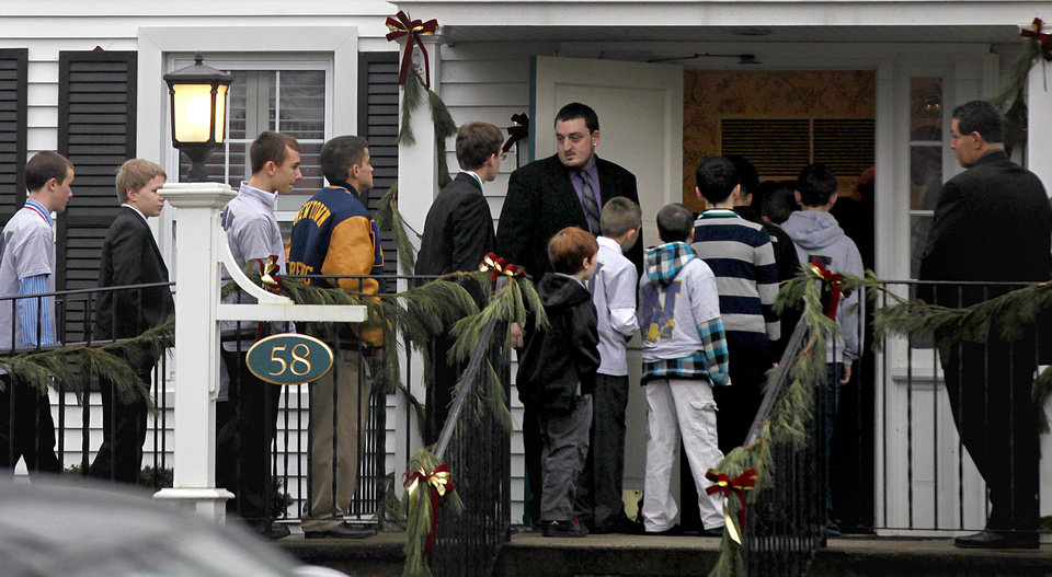 Mourners arrive for the funeral service of Sandy Hook Elementary School shooting victim, 6-year-old Jack Pinto, Monday, Dec. 17, 2012, in Newtown, Conn. Pinto was killed when a gunman walked into Sandy Hook Elementary School in Newtown Friday and opened fire, killing 26 people, including 20 children.(AP Photo/David Goldman)