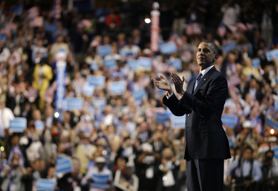 Photo -   President Barack Obama waves after his speech at the Democratic National Convention in Charlotte, N.C., on Thursday, Sept. 6, 2012. (AP Photo/David Goldman)