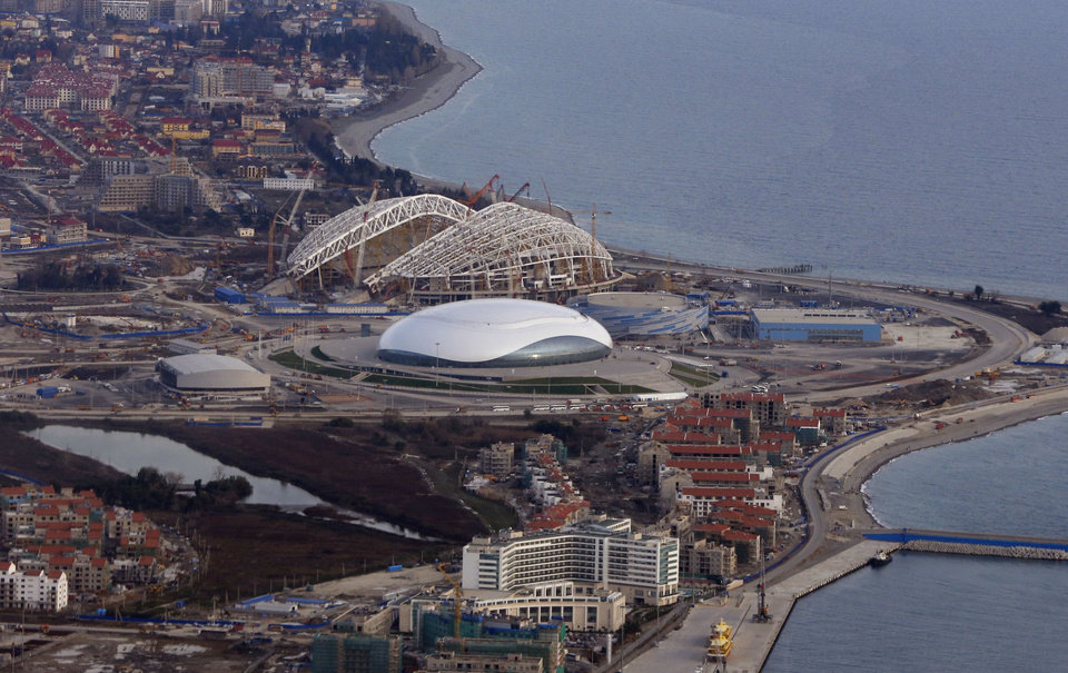 Photo - FILE - This Feb. 4, 2013 file photo shows an aerial view of the Olympic Park under construction for the Winter Olympics in Sochi, Russia. The 2014 Winter Olympics will kick off on Feb. 7, 2014. You'd have to be a dope to try to get away with doping at the Sochi Olympics. That's the picture painted by international Olympic and anti-doping officials as they implement the toughest drug-testing program in Winter Games history.Using intelligence to target athletes and events considered most at risk, authorities are focusing their efforts on weeding out drug cheats through rigorous pre-games and pre-competition tests. (AP Photo/Dmitry Lovetsky, File)