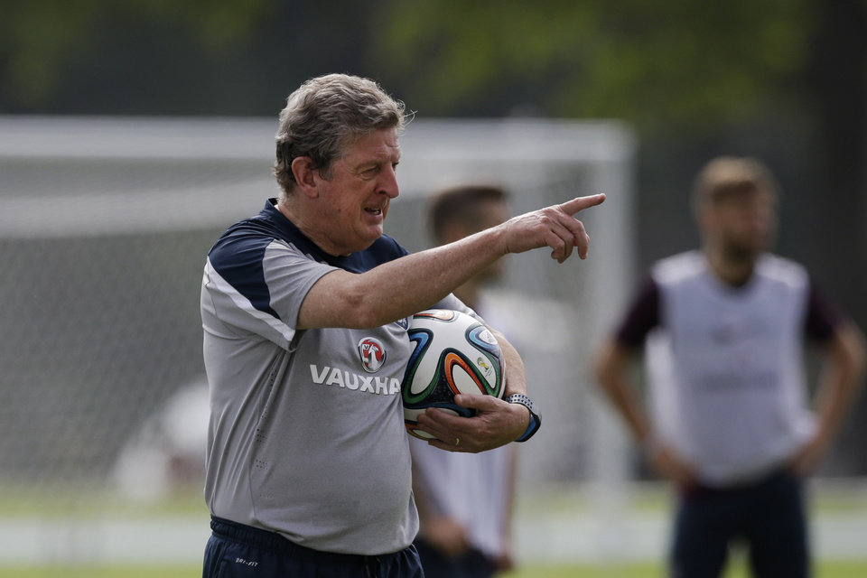 Photo - England national soccer team head coach Roy Hodgson points during a squad training session for the 2014 soccer World Cup at the Urca military base in Rio de Janeiro, Brazil, Saturday, June 21, 2014.  Costa Rica's surprise 1-0 win over Italy on Friday meant that England made its most humiliating exit from a World Cup since 1958, following consecutive defeats by the Italians and then Uruguay in Group D.  England play Costa Rica in their final Group D match on Tuesday.  (AP Photo/Matt Dunham)