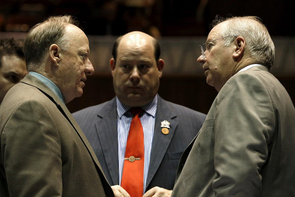 Photo - House Speaker Rep. Andy Tobin, R-Paulden, right, talks with Majority Whip Rep. Rick Gray, R-Sun City, left, and Majority Leader Rep. David Gowan, Sr., R-Sierra Vista, in a special session budget battle for Medicaid funding on Wednesday, June 12, 2013, in Phoenix.  The Arizona Legislature is on track to pull an all-nighter and work into Thursday to finish a state budget and approve Medicaid expansion. (AP Photo/Ross D. Franklin)
