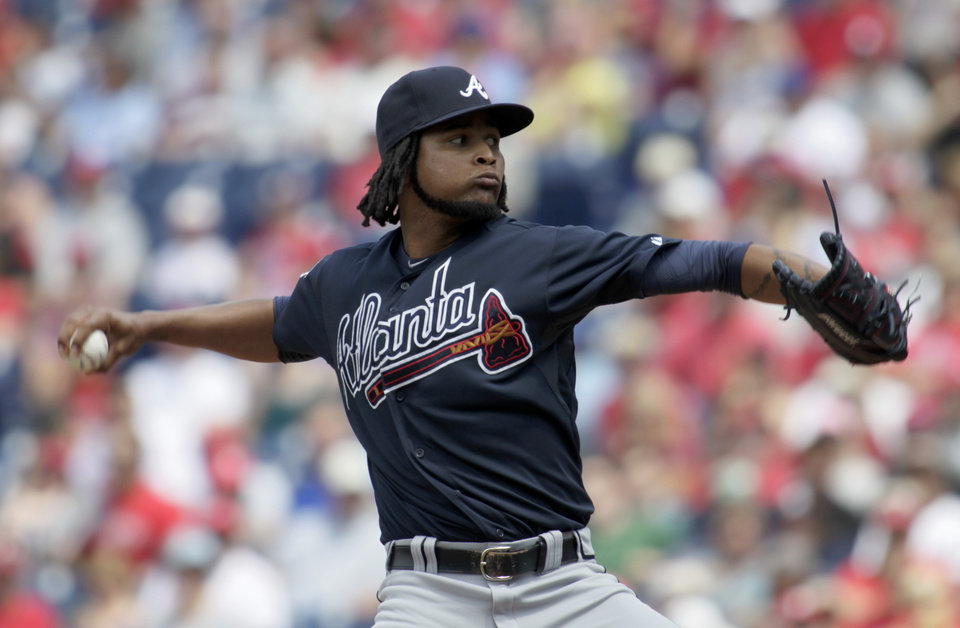 Photo - Atlanta Braves starting pitcher Ervin Santana throws against the Philadelphia Phillies in the first inning of the first game of a baseball double-header Saturday, June 28, 2014, in Philadelphia.  (AP Photo/H. Rumph Jr)