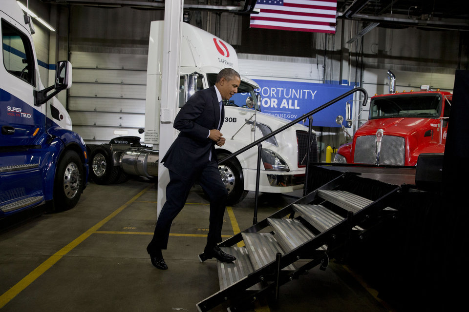 Photo - President Barack Obama arrives to speak about how having a fuel-efficient truck fleet will boost the economy and help combat climate change, Tuesday, Feb. 18, 2014, at the Safeway Distribution Center in Upper Marlboro, Md. (AP Photo/Jacquelyn Martin)