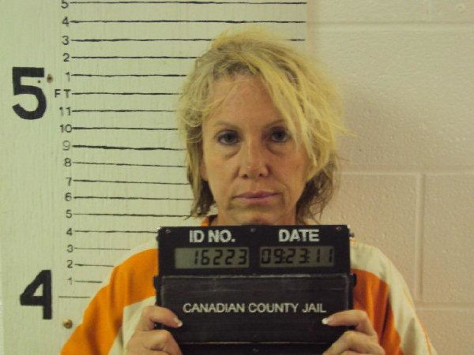 Rebecca Bryan's mug shot from the Canadian County jail. Bryan was arrested Friday in connection with the shooting death of her husband. <strong></strong>