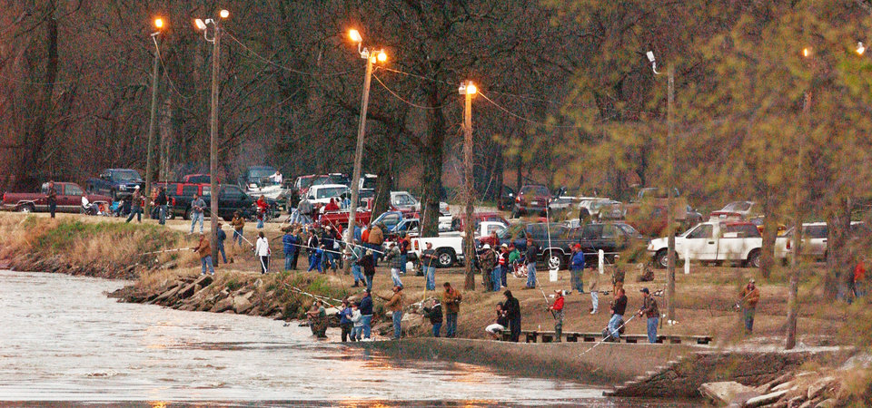 Paddlefish anglers swarmed the banks of the Neosho River in Miami's Riverview Park on Wednesday night to try and snag a spoonbill. PHOTO BY GARY CROW FOR THE OKLAHOMAN