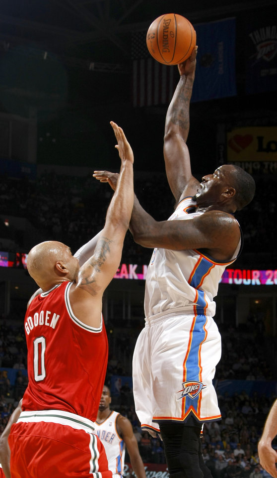 Photo - Oklahoma City's Kendrick Perkins (5) shoots the ball over Milwaukee's Drew Gooden (0) during the NBA basketball game between the Oklahoma City Thunder and the Milwaukee Bucks at the Oklahoma City Arena, Wednesday, April 13, 2011. Photo by Bryan Terry, The Oklahoman