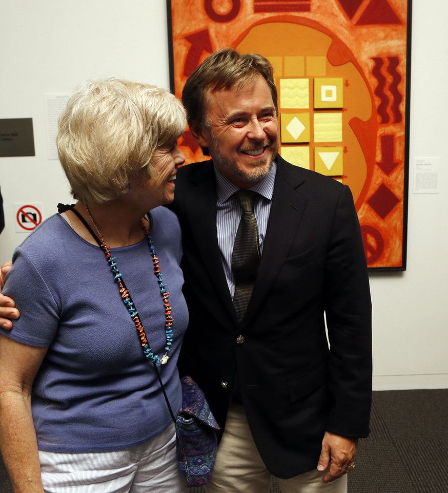 Ghislain d'Humieres hugs Mayor Cindy Rosenthal on Wednesday, Aug. 28, 2013 in Norman, Okla, as friends say goodbye.  The museum's director is leaving his post at Fred Jones Jr. Art Museum at the University of Oklahoma (OU).  Photo by Steve Sisney, The Oklahoman