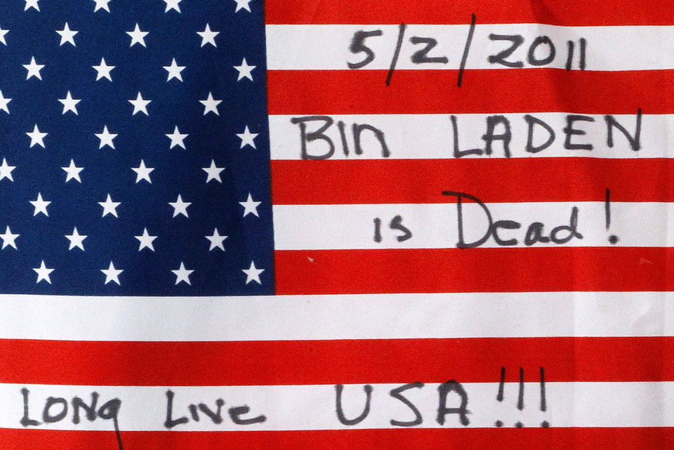 Photo - This is a flag placed at the temporary memorial to United Flight 93 in Shanksville, Pa., on Monday, May 2, 2011. Osama bin Laden, the face of global terrorism and architect of the Sept. 11, 2001, attacks, was killed in a firefight with elite American forces in Pakistan on Monday, May 2, 2011 then quickly buried at sea. (AP Photo/Gene J. Puskar) ORG XMIT: PAGP108