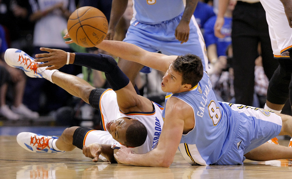 Oklahoma City's Russell Westbrook (0) and Denver's Danilo Gallinari (8) battle for a loose ball during the first round NBA playoff game between the Oklahoma City Thunder and the Denver Nuggets on Sunday, April 17, 2011, in Oklahoma City, Okla. Photo by Chris Landsberger, The Oklahoman