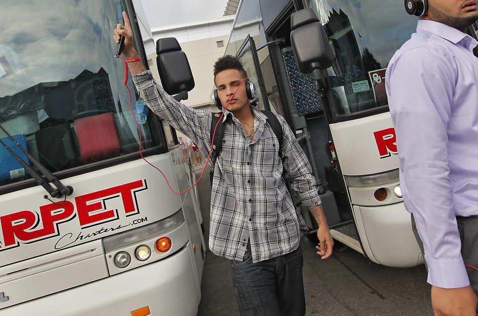 Photo - Oklahoma's Kenny Stills reacts to the Sooner fans as he gets off the team bus during the Red River Rivalry college football game between the University of Oklahoma Sooners (OU) and the University of Texas Longhorns (UT) at the Cotton Bowl in Dallas, Saturday, Oct. 8, 2011. Photo by Chris Landsberger, The Oklahoman