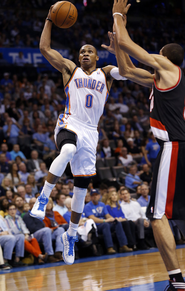 Russell Westbrook (0) shoots defended by Nicolas Batum as the Oklahoma City Thunder play the Portland Trail Blazers in NBA basketball at the Chesapeake Energy Arena in Oklahoma City, on Friday, Nov. 2, 2012.  Photo by Steve Sisney, The Oklahoman