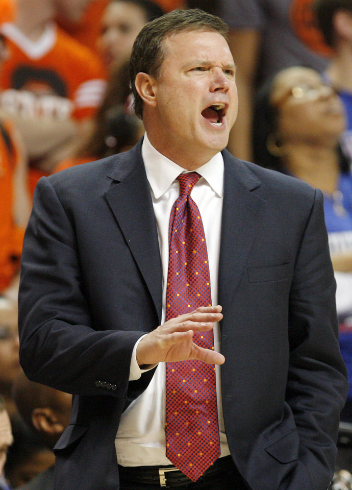 Photo - KU head coach Bill Self yells at his team in the second half during the men's college basketball game between the University of Kansas (KU) and Oklahoma State University (OSU) at Gallagher-Iba Arena in Stillwater, Okla., Saturday, Feb. 27, 2010. OSU won, 85-77. Photo by Nate Billings, The Oklahoman