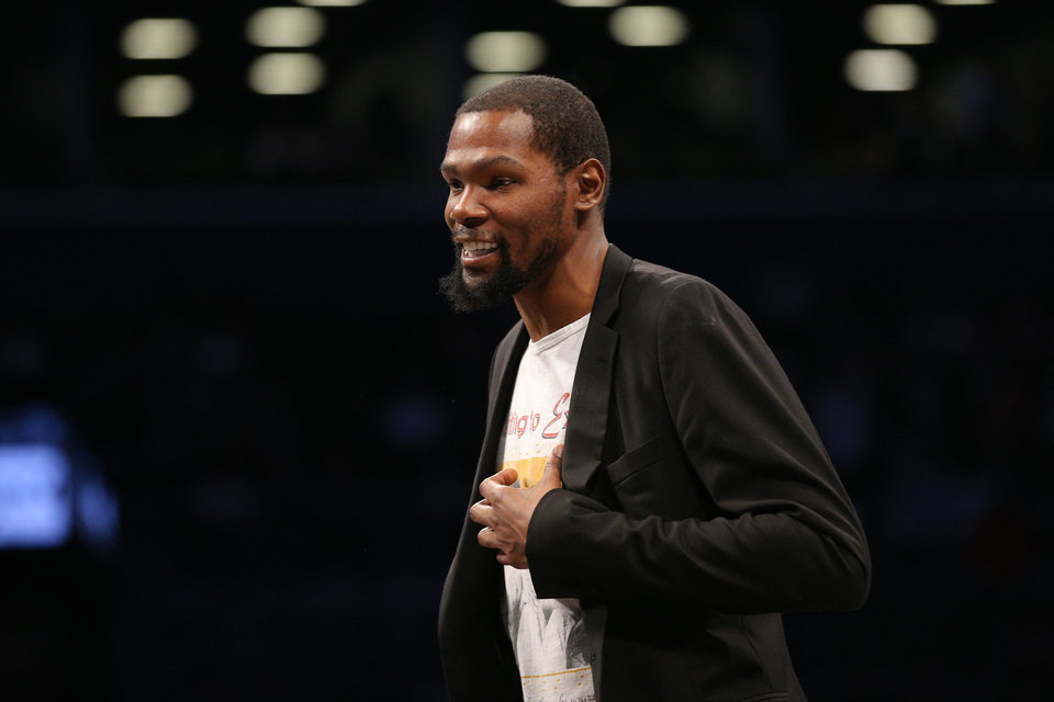 Photo - Feb 3, 2020; Brooklyn, New York, USA; Brooklyn Nets small forward Kevin Durant (7) smiles during a time out during the second quarter against the Phoenix Suns at Barclays Center. Mandatory Credit: Brad Penner-USA TODAY Sports