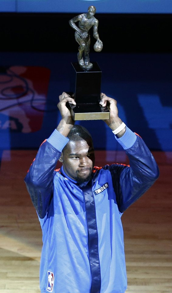 Photo - Oklahoma City's Kevin Durant (35) holds the MVP trophy before Game 2 of the Western Conference semifinals in the NBA playoffs between the Oklahoma City Thunder and the Los Angeles Clippers at Chesapeake Energy Arena in Oklahoma City, Wednesday, May 7, 2014. PHOTO BY SARAH PHIPPS, The Oklahoman