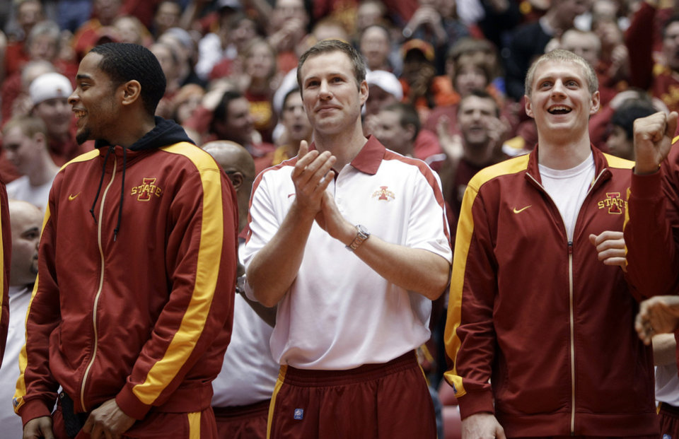Iowa State coach Fred Hoiberg, center, reacts with guard Chris Allen, left, and guard Scott Christopherson, right, after the announcement that Iowa State will play Connecticut in the first round of the NCAA college basketball tournament, during a selection-show party Sunday, March 11, 2012, in Ames, Iowa. (AP Photo/Charlie Neibergall) ORG XMIT: IACN103