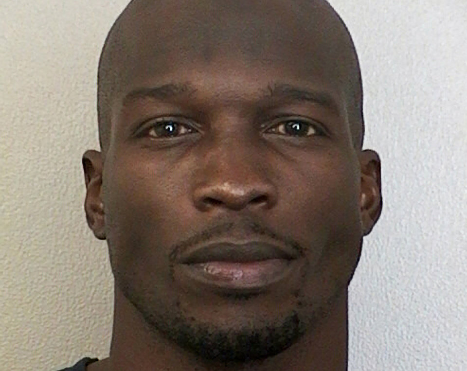 Photo -   This undated photo provided by the Broward Sheriff's Office shows Miami Dolphins wide receiver Chad Johnson. A judge has set bond at $2,500 for Johnson, who is being held in a Florida jail on a domestic violence charge after his wife accused him of head-butting her during an argument. Johnson's defense attorney, Adam Swickle, says Johnson posted the bond early Sunday, Aug. 12, 2012, though jail records show he had not yet been released. Swickle says a no-contact order has been issued that prevents Johnson from contacting his wife, Evelyn Lozada. (AP Photo/Broward Sheriff's Office)