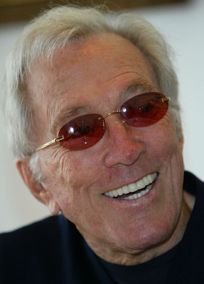 "FILE - In this July 25, 2004 file photo, U.S. singer Andy Williams smiles as he speaks to reporters during his news conference at a Tokyo hotel. Emmy-winning TV host and ""Moon River"" crooner Williams died Tuesday night, Sept, 25, 2012 at his home in Branson, Mo., following a year-long battle with bladder cancer. He was 84. (AP Photo/Shizuo Kambayashi, File)"