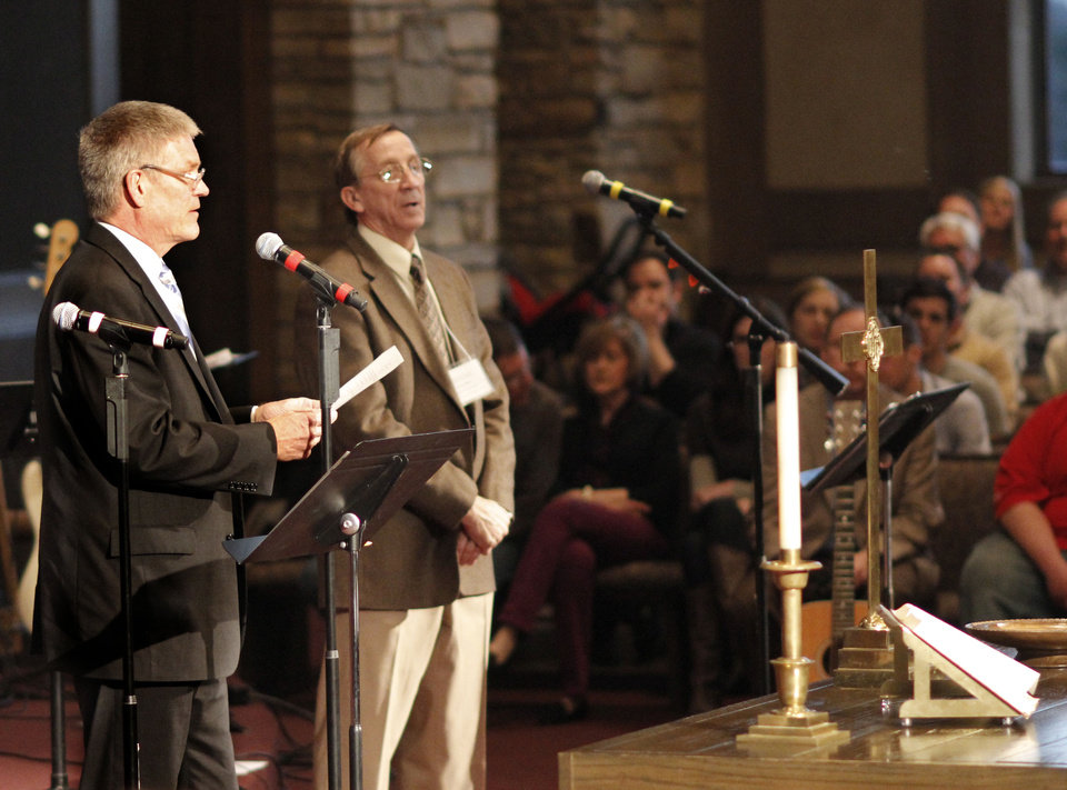 Photo - Mark Wesner and Tom Laubert, representing the Indian Nations Presbytery's administrative commission, announce the results of a churchwide vote Sunday at First Presbyterian Church of Edmond, 1001 S Rankin of Edmond.   DOUG HOKE - THE OKLAHOMAN