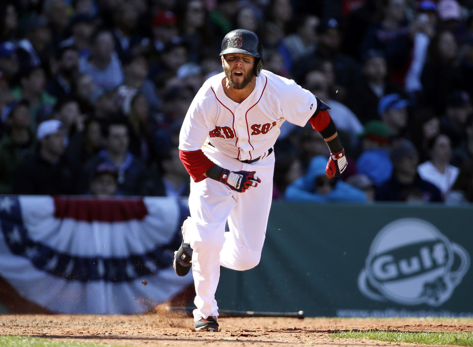 Photo - Boston Red Sox's Dustin Pedroia reacts as he grounds out in the fifth inning of a baseball game against the Milwaukee Brewers, Sunday, April 6, 2014, in Boston. (AP Photo/Steven Senne)