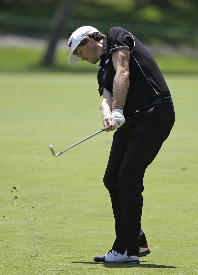 Photo - Keegan Bradley hits from the second fairway during the second round of the Memorial golf tournament Friday, May 30, 2014, in Dublin, Ohio. (AP Photo/Darron Cummings)
