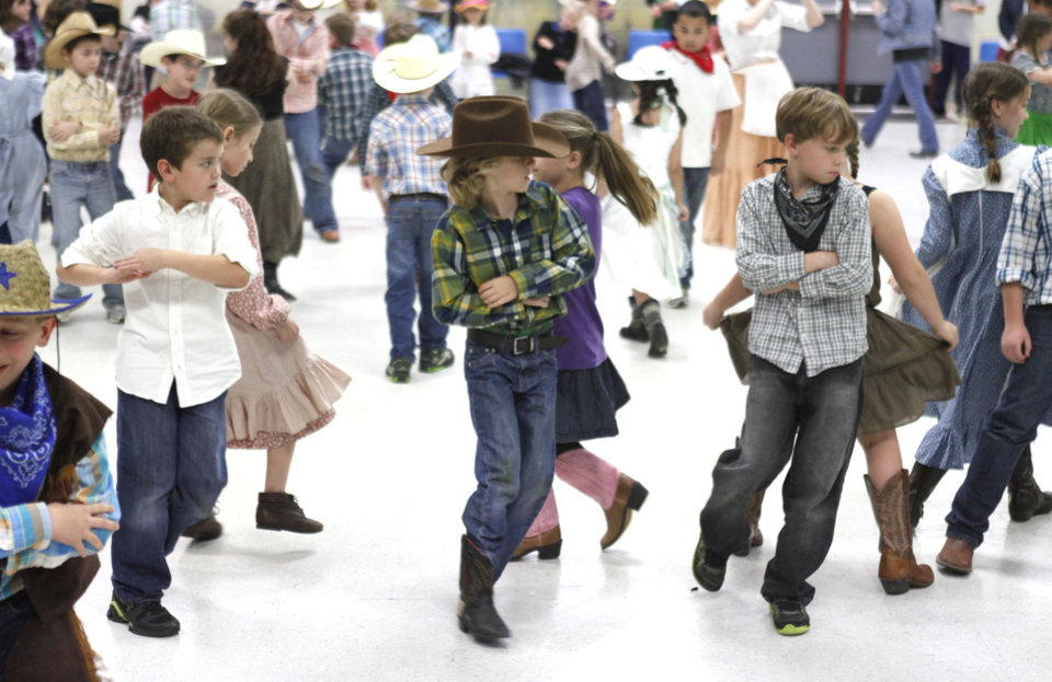 Students at Chisholm Elementary School do the Virginia Reel and other dances during a hootenanny at the school in Edmond, OK, Friday, April 26, 2013,  By Paul Hellstern, The Oklahoman