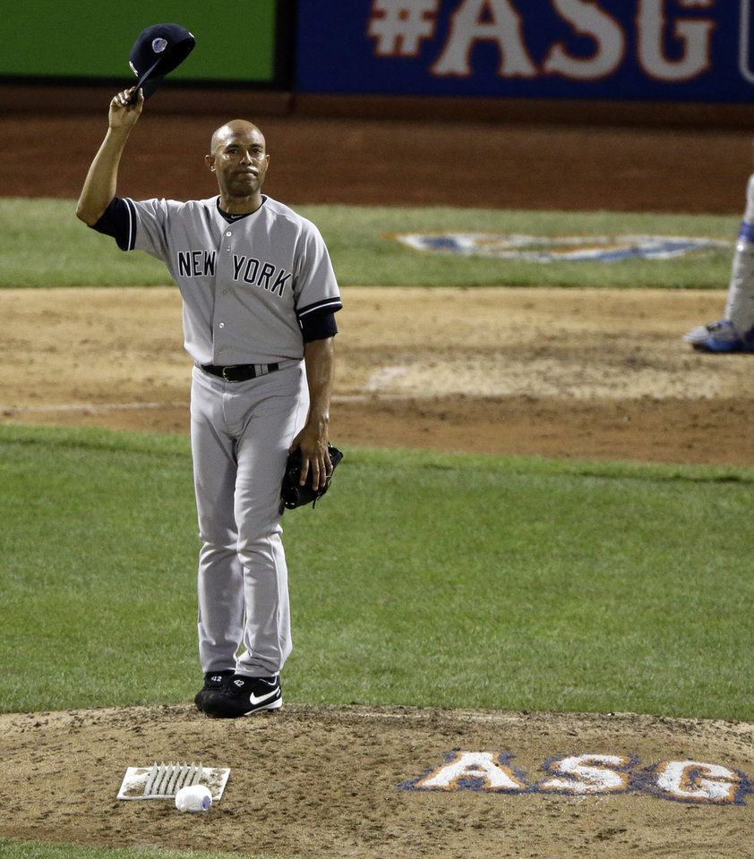Photo - American League's Mariano Rivera, of the New York Yankees, acknowledges the crowd as he is introduced during the eighth inning of the MLB All-Star baseball game, on Tuesday, July 16, 2013, in New York. (AP Photo/Frank Franklin II)