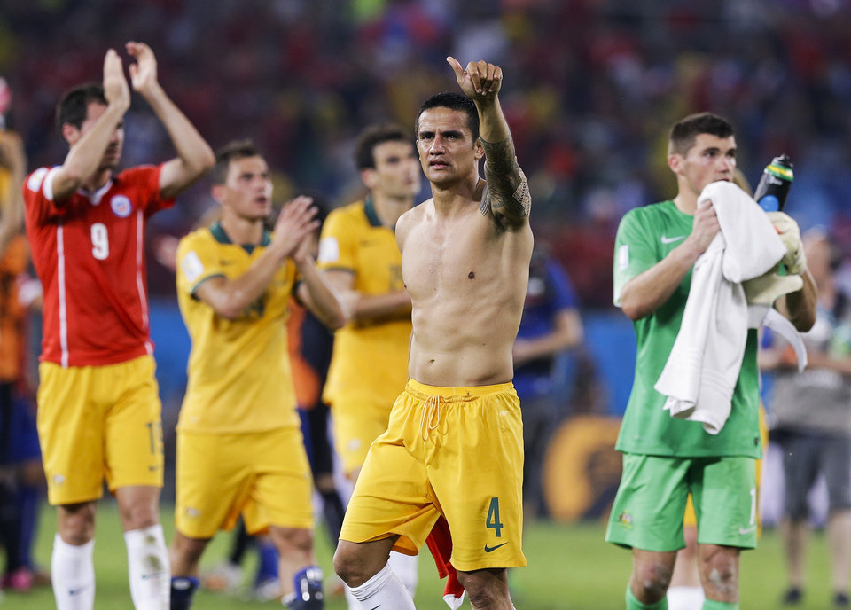 Photo - Australia's Tim Cahill (4) salutes spectators following their 3-1 loss to Chile during the group B World Cup soccer match between Chile and Australia in the Arena Pantanal in Cuiaba, Brazil, Friday, June 13, 2014. (AP Photo/Thanassis Stavrakis)