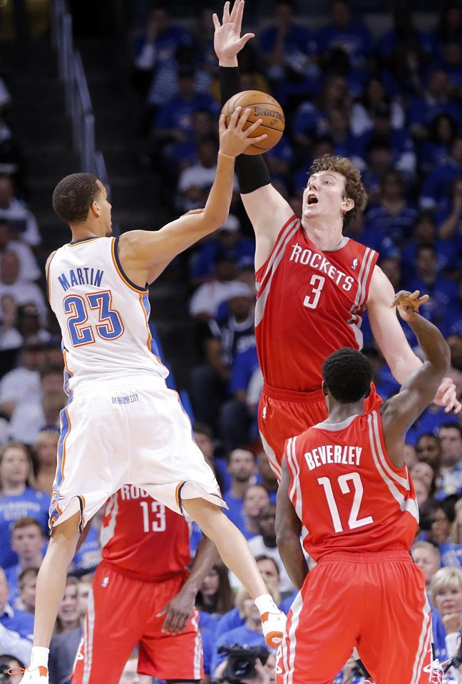 Houston's Omer Asik (3) defends on Oklahoma City's Kevin Martin (23) during Game 2 in the first round of the NBA playoffs between the Oklahoma City Thunder and the Houston Rockets at Chesapeake Energy Arena in Oklahoma City, Wednesday, April 24, 2013. Photo by Chris Landsberger, The Oklahoman