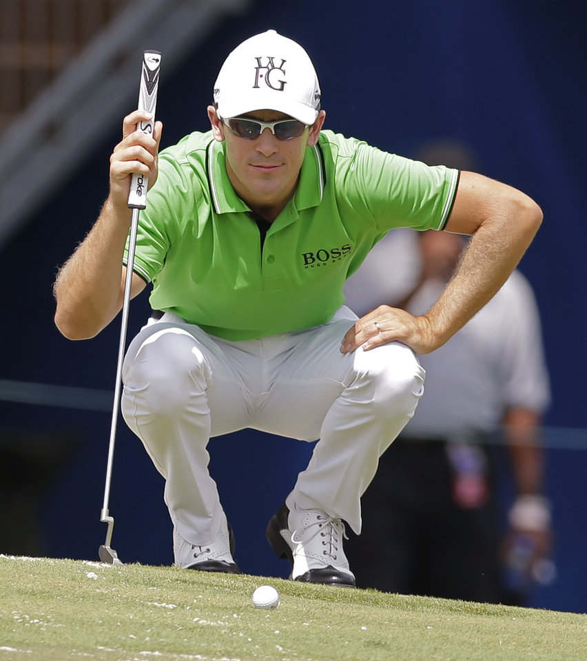 Photo - Scott Langley lines up a putt on the 18th hole during the second round of the Wyndham Championship golf tournament in Greensboro, N.C., Friday, Aug. 15, 2014. (AP Photo/Chuck Burton)