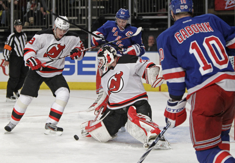 Photo -   New York Rangers right wing Marian Gaborik (10) watches as New Jersey Devils goalie Martin Brodeur (30) blocks a shot with his knee pad with Devils defenseman Anton Volchenkov (28) and Rangers right wing Ryan Callahan (24) watch in the second period of their NHL hockey game at Madison Square Garden in New York, Monday, Feb. 27, 2012. (AP Photo/Kathy Willens)