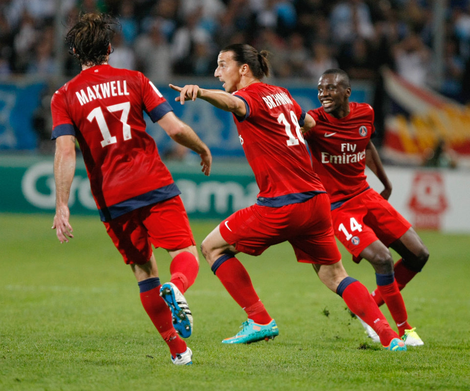 Photo -   Paris Saint Germain's Swedish forward Zlatan Ibrahimovic, center, reacts with Brazilian defender Maxwell, left, and French midfielder Blaise Matuidi after scoring against Marseille, during their League One soccer match, in Marseille, southern France, Sunday, Oct. 7, 2012. (AP Photo/Claude Paris)