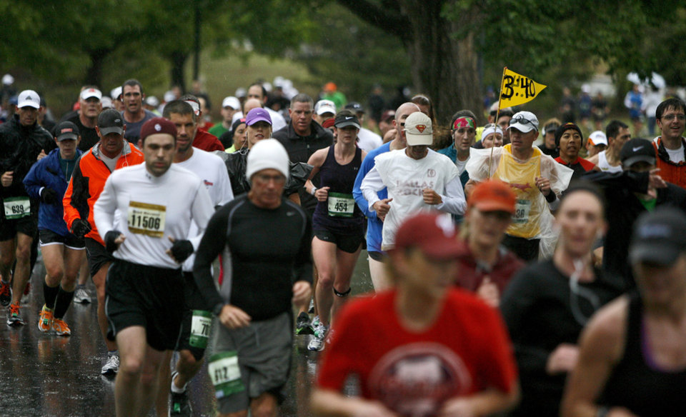 Photo - Runners make their way down nw 35th during the Oklahoma City Memorial Marathon on Sunday, May 1, 2011. Photo by Bryan Terry, The Oklahoman