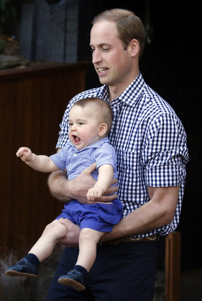 Photo -  His Royal Highness Prince William, holds his son Prince George during a visit to Sydney's Taronga Zoo April 20, 2014. The Prince and his wife Kate are undertaking a 19-day official visit to New Zealand and Australia with their son George. (AP Photo/David Gray/Pool)