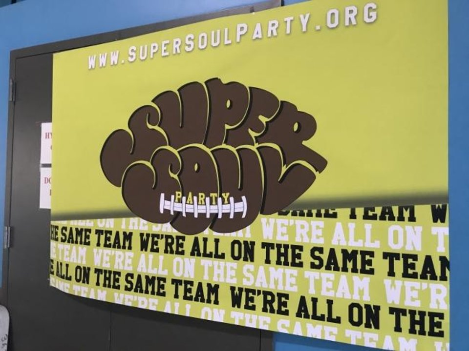 Photo -  A Super Soul Party banner is shown on the wall of the Oklahoma City Homeless Alliance's day shelter.  [Carla Hinton/The Oklahoman]