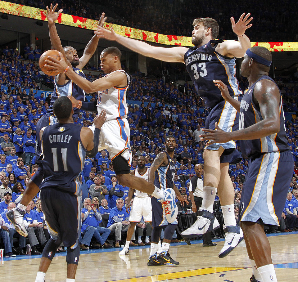 Oklahoma City\'s Russell Westbrook (0) drives to the basket past Tony Allen of Memphis, Marc Gasol (33) of Memphis and Mike Conley (11) of Memphis during game two of the Western Conference semifinals between the Memphis Grizzlies and the Oklahoma City Thunder in the NBA basketball playoffs at Oklahoma City Arena in Oklahoma City, Tuesday, May 3, 2011. Photo by Chris Landsberger, The Oklahoman ORG XMIT: KOD