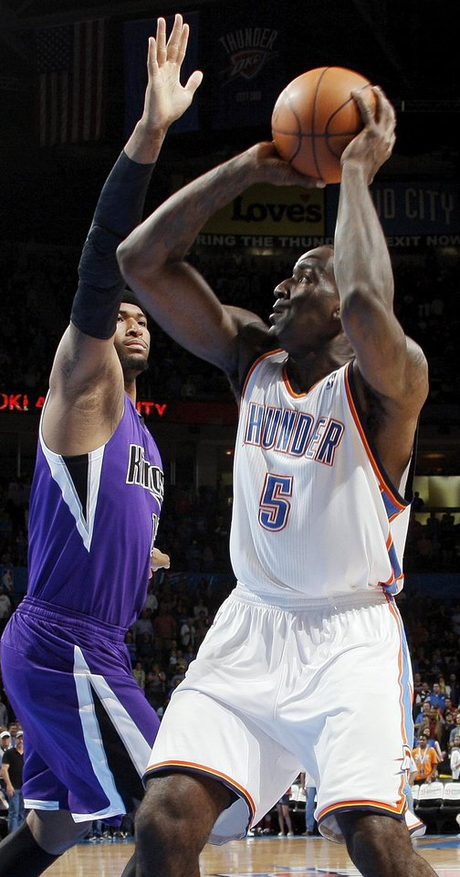 Oklahoma City's Kendrick Perkins (5) shoots against Sacramento's DeMarcus Cousins (15) during the NBA basketball game between the Oklahoma City Thunder and the Sacramento Kings at Chesapeake Energy Arena in Oklahoma City, Friday, April 13, 2012. Photo by Nate Billings, The Oklahoman