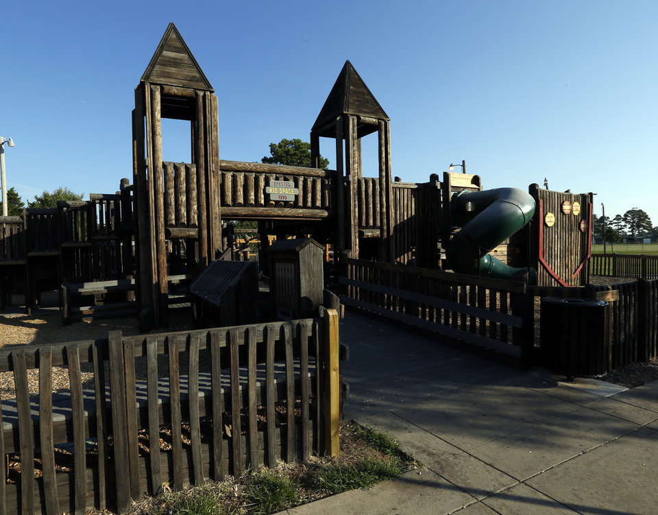 Photo - BOTTOM, RIGHT:  Kids Space playground at Reaves Park would have to be moved or rebuilt if the land swap happened.  PHOTOS BY STEVE SISNEY, THE OKLAHOMAN  STEVE SISNEY -