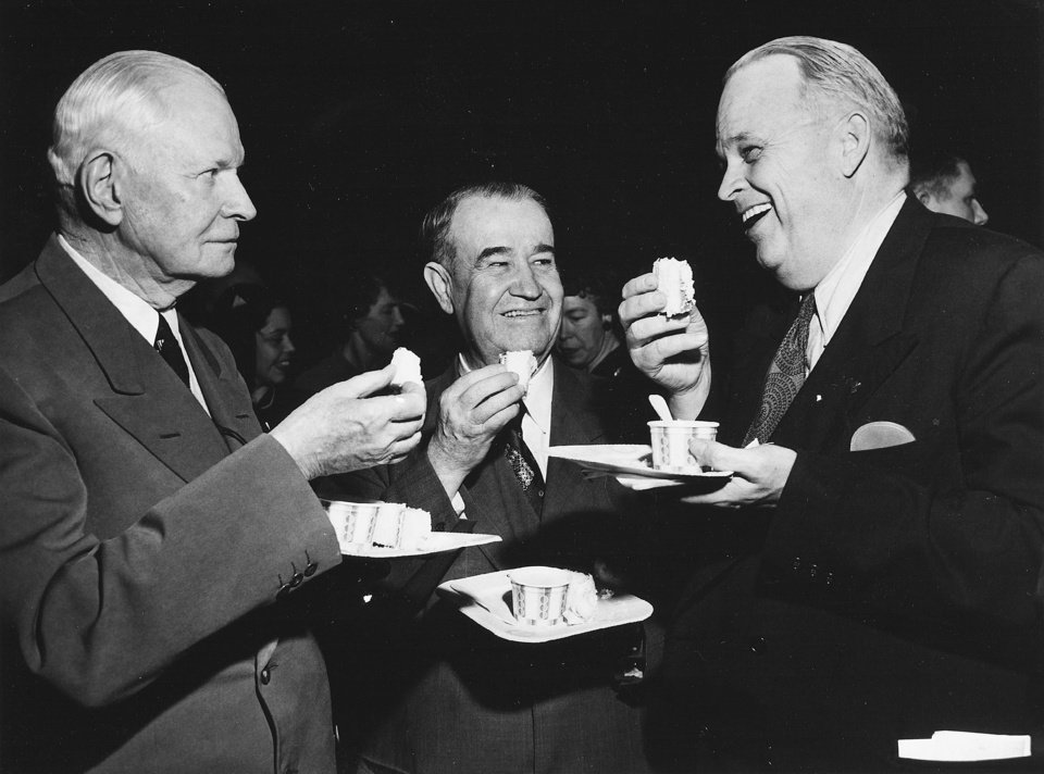 A&M / COLLEGE: Dr. Henry G. Bennett, Oklahoma A&M college president (center), enjoys a laugh and shares some cake with Oklahoma U.S. Senators Elmer Thomas (left) and Robert S. Kerr (right) during a celebration of Dr. Bennett's 63rd birthday in the fieldhouse on the Oklahoma A&M Stillwater campus.  More than 2,000 people attended the fete to honor Dr. Bennett, who at that time had spent nearly 22 years as the head of the institution for higher learning. Staff photo by Bill Johnson taken 12/16/49.