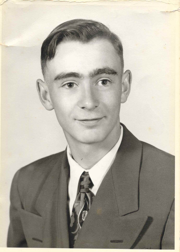 Photo -  Kenneth R. Raymond in a high school graduation photo.