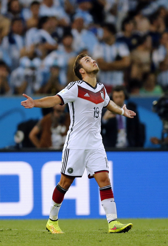 Photo - Germany's Mario Goetze celebrates after scoring the opening goal during the World Cup final soccer match between Germany and Argentina at the Maracana Stadium in Rio de Janeiro, Brazil, Sunday, July 13, 2014. Germany beat Argentina 1-0 to win the World Cup. (AP Photo/Frank Augstein)